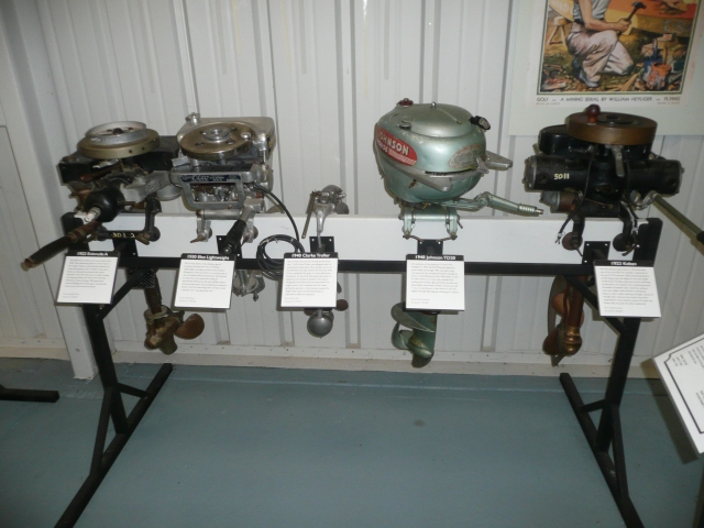 1922 Evenrude Motor on the left