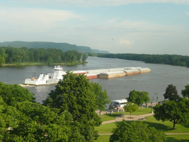 View from our room of the mighty Mississippi with a Tug & 11 barges
