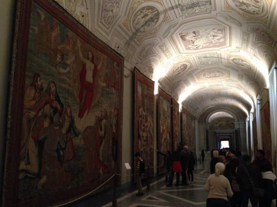 The hall with painted ceiling & tapestries down each wall